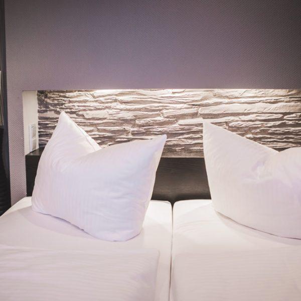 Das Bett im Economy Doppelzimmer